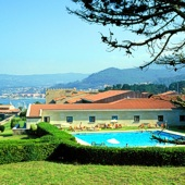 Swimming pool at Parador Baiona Bayona